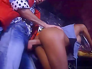 Retro ebony chick in shiny boots gets fucked in a bar
